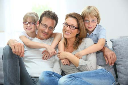 29377900 - portrait of happy family of four wearing eyeglasses